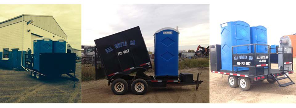 Three portable toilets on trailers